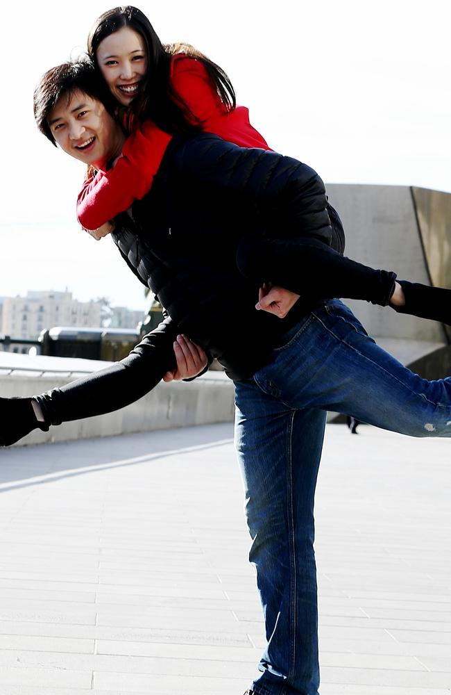 Chengwu and Ako can't resist striking a pose in Southbank. Picture: Tim Carrafa