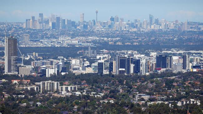 The skyline of Parramatta (front) is the geographical heart of Greater Sydney, with Sydney's CBD about 25km east.