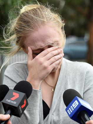 Sarah Smith breaks down at the scene of the tragic crash. Picture: Steve Tanner