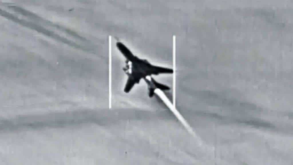 """A Syrian Government Su-22 """"Fitter"""" combat jet is seen in the crosshairs of a US Navy F/A-18 Super Hornet moments before it was shot down."""