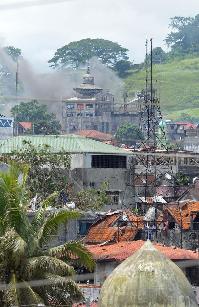 Smoke billows after aerial bombings by the Philippine air force on a militant's position in Marawi on the southern island of Mindanao on June 22, 2017. Picture: Ted Aljibe