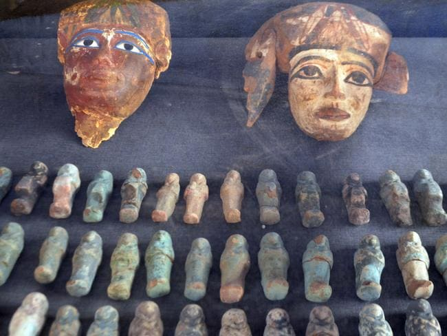 Ancient Egyptian wooden masks and small statuettes were also found. Photo: AFP/STRINGER