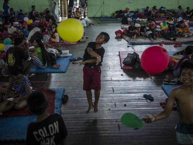 Kids playing at an evacuation centre in Klungkung regency, Bali. Indonesian authorities raised the alert level for the Mount Agung volcano to the highest level as up to 30,000 villagers around the mountain evacuated their homes. Picture: Ulet Ifansasti / Getty