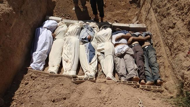 A photo distributed by the Associated Press purports to show several bodies being buried in a suburb of Damascus, Syria during a funeral on Wednesday, Aug. 21, 2013.