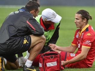 Michael Marrone of United is injured during the A-League Grand Final between Adelaide United and the Western Sydney Wanderers at Adelaide Oval in Adelaide, Sunday, May 1, 2016. (AAP Image/David Mariuz) NO ARCHIVING, EDITORIAL USE ONLY