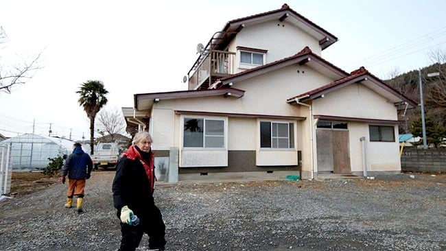 David Chandlee in front of a house donated to INJM in Ishinomaki / Picture: Helen Davidson