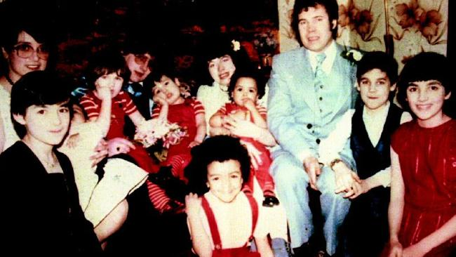 Rosemary West, left, and Fred West right with some of their family, including daughter, Heather, far right, whom they murdered. Picture: Supplied