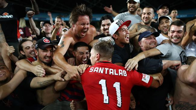 Brendon Santalab of the Wanderers celebrates with the RBB after scoring the winner.