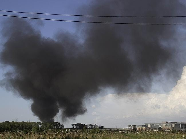 Battle ... Black smoke billows from Donetsk international airport duringa heavy gunbattle between the Ukrainian army and pro-Russian militants on May 26. Picture: AFP