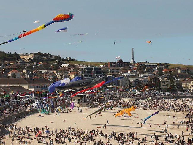 Kite mecca: a dazzling aerial armada soars above the sky during the annual Festival of the Winds kite flying festival on Bondi Beach.