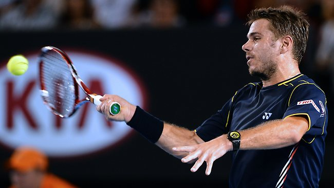 Switzerland's Stanislas Wawrinka plays a return against Serbia's Novak Djokovic. Picture: William West