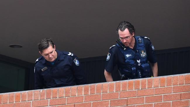 Police look over the crime scene at Somerville House. Picture: AAP/Darren England