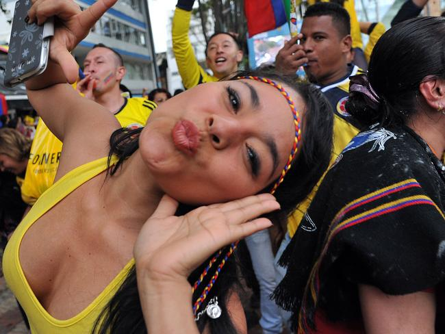 A Colombian fan celebrates.
