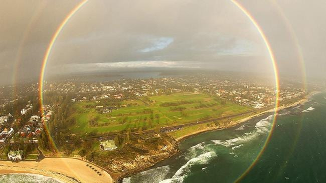 While in a helicopter with the sunset behind him and a rain shower ahead, this photographer was able to capture a full-circle rainbow over Cottesloe Beach in Western Australia. Pictured Colin Leonhardt/
