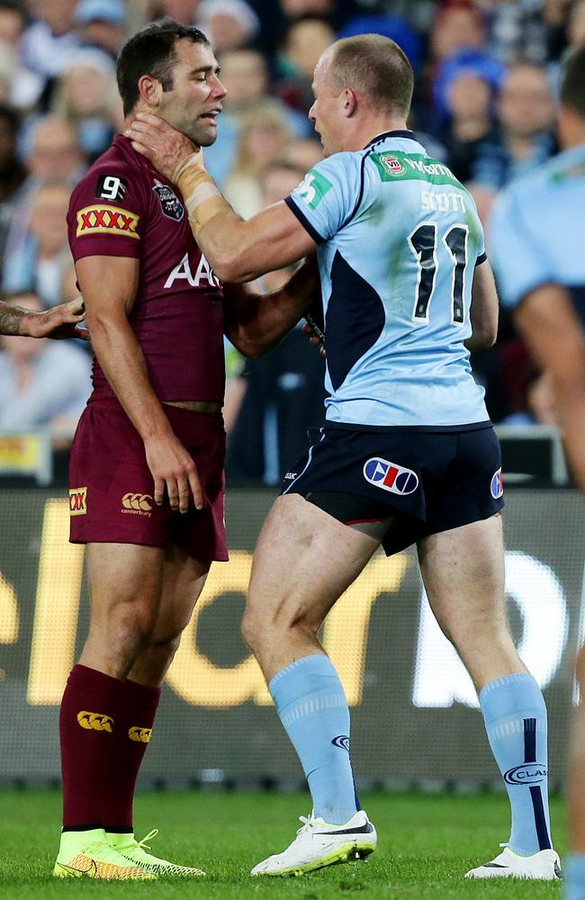 Cameron Smith and Beau Scott scuffle. Picture: Peter Wallis