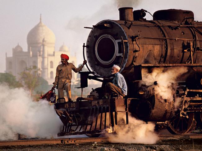 Steve McCurry: India exhibtion - Steam engine passes in front of the Taj Mahal, Agra, Uttar Pradesh,1983. Picture: Steve McCurry