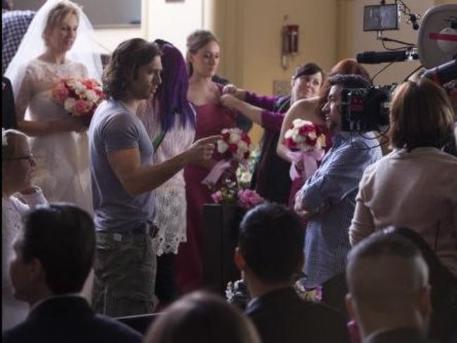 New love ... Glee co-creator Brad Falchuk, left, gives instructions on set. Picture: Twitter