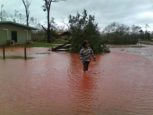 Ramingining residents venture out after Tropical Cyclone Lam passed the remote community. Picture: Carli Merkel