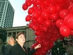 Bruce and Denise launch 1000 red balloons in April 2004 in their quest to find their missing son Daniel. Picture: Bob Fenney