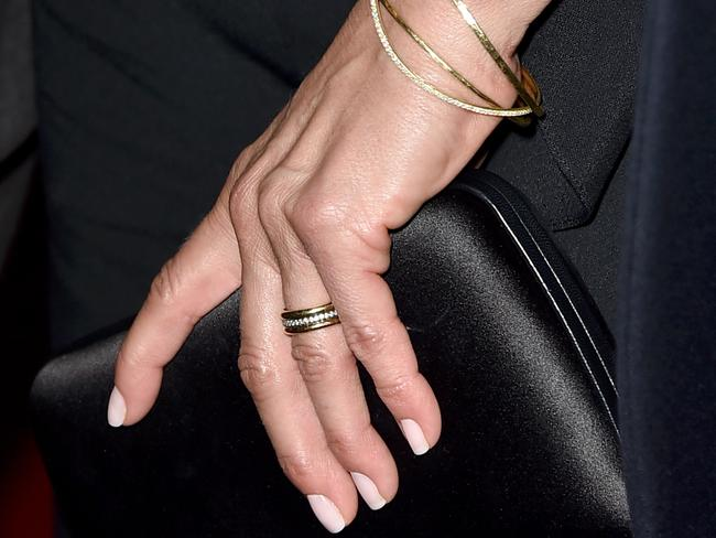 Aniston showed off her gold wedding ring.