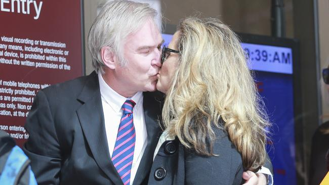 Kathy Jackson kisses partner Michael Lawler as they arrive at the Magistrates court in Melbourne. Picture: AAP.