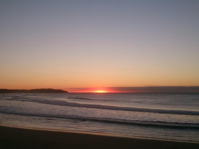 Is it a UFO or is the sun rising ... a possible sighting off Dee Why on Sydney's northern beaches.