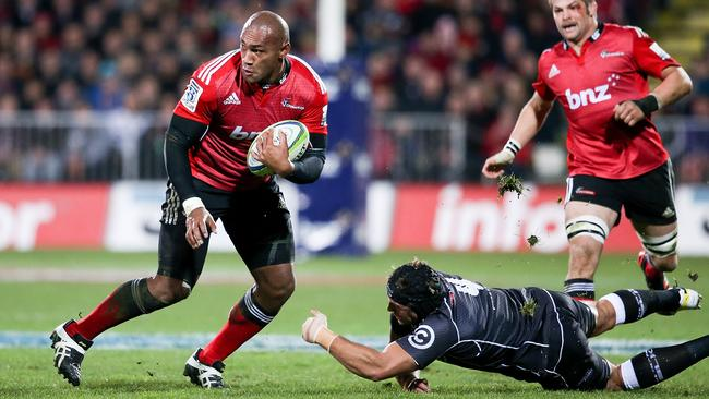 Crusaders winger Nemani Nadolo breaks out of a Sharks tackle.