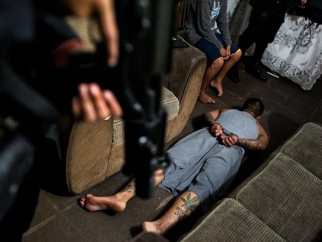 This alleged gang member was thrown to the floor and handcuffed by police. Picture: Jan Sochor.