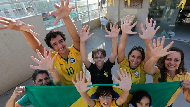 Six appeal! Members of the Silva family. The family was born with an extra digit on each hand as a result of a genetic condition known as polydactyly. (AP Photo/Eraldo Peres)