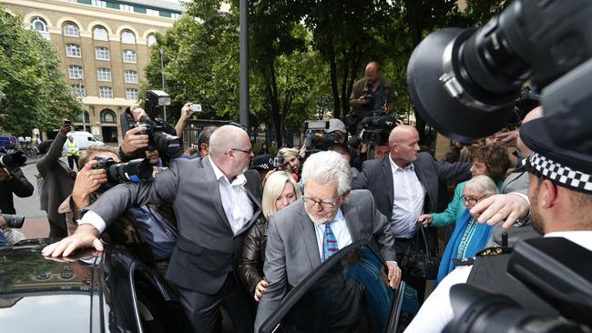 Guilty... Rolf Harris, accompanied by members of his family and security, and surrounded by members of the media, leaves the Southwark Crown Court in London. Picture: AP