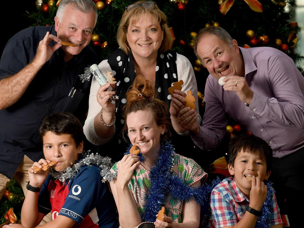 SUGAR AND SPICE: Our taste test team, from left top, Tony Love, Dianne Mattsson, Simon Wilkinson, Liam Powney, 11, Emma Shearer and Benjamin Powney, 9, bite into their festive treats.  <b>Picture: NAOMI JELLICOE</b>