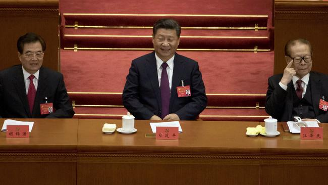 Chinese President Xi Jinping (centre) sits with former Chinese President Hu Jintao (left) and Jiang Zemin. Picture: Ng Han Guan/AP