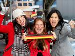 Leanne Yin, Helene Herges and Natalie Wan are fired up outside the German Club before the World Cup final. Picture: Simon Cross