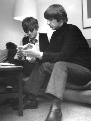 John Lennon and Ringo Starr relax in a motel room in Melbourne. Picture: Herald Sum Image Library