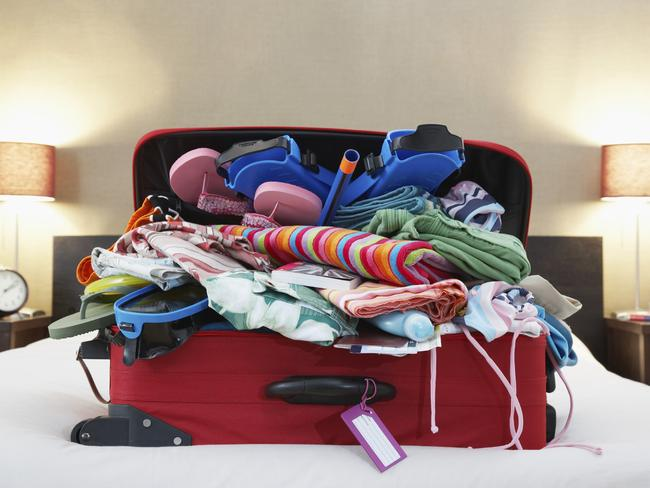 It's nice to have everything you'll need and more, but it's not nice lugging this junk around on holiday. Picture: iStock