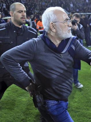 PAOK owner, businessman Ivan Savvidis invades into the pitch during a Greek League soccer match between PAOK and AEK Athens