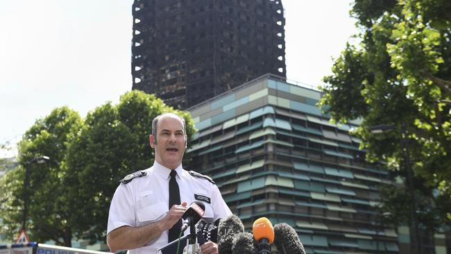 Metropolitan Police Commander Stuart Cundy speaking outside the charred tower in west London. Picture: Victoria Jones/PA via AP.