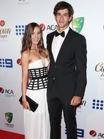 Madeline Hay and Ashton Agar on the red carpet arriving at the 2014 Allan Border Medal held at Doltone House at Hyde Park.