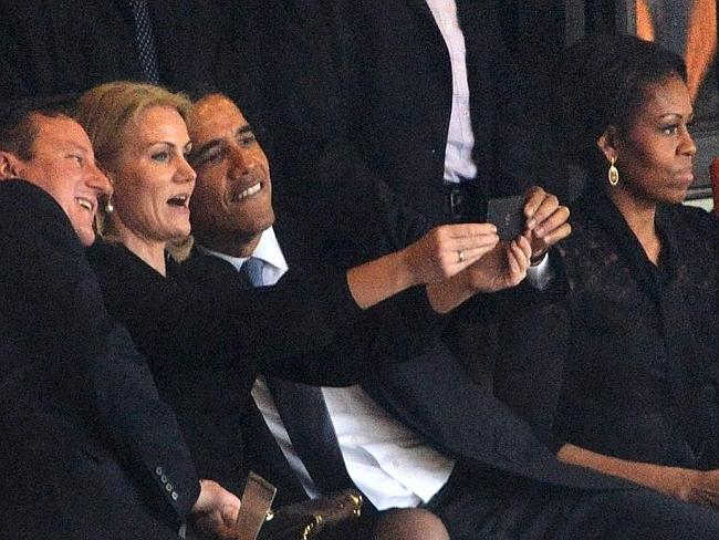 One of the most famous selfies from 2013 ... President Barack Obama (right) and British Prime Minister David Cameron by Denmark's Prime Minister Helle Thorning Schmidt (centre) at Nelson Mandela's memorial.