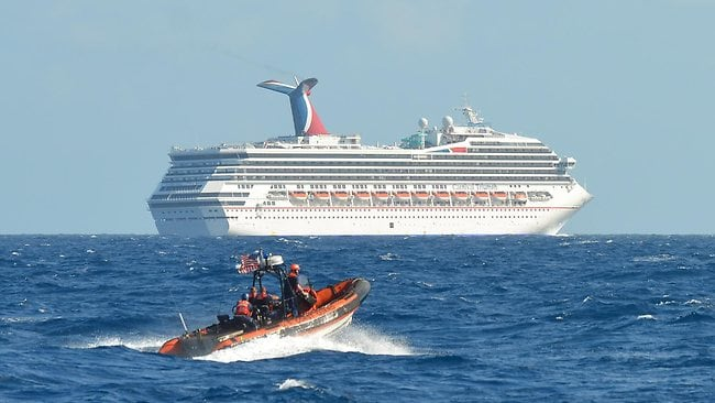 A small boat belonging to the Coast Guard Cutter Vigorous patrols near the cruise ship Carnival Triumph in the Gulf of Mexico. Picture: U.S. Coast Guard /Lt. Cmdr. Paul McConnell