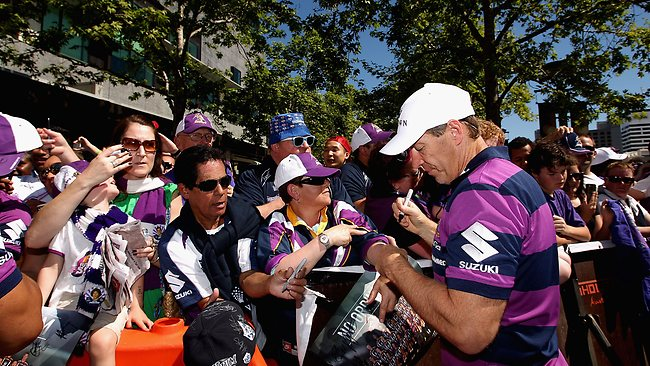Coach Craig Bellamy signs autographs for fans during the Melbourne Storm NRL Grand Final civic reception at Crown Entertainment Complex in Melbourne. Picture: Robert Prezioso