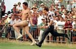 <p>A streaker is chased across the 18th green by a marshall at Royal Lytham and St Annes in 1996.</p>