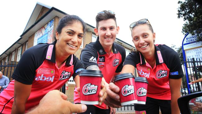 Lisa Sthalekar, Nic Maddinson and Ashleigh Gardner of the Sydney Sixers celebrate the start of summer. Picture: Mark Evans