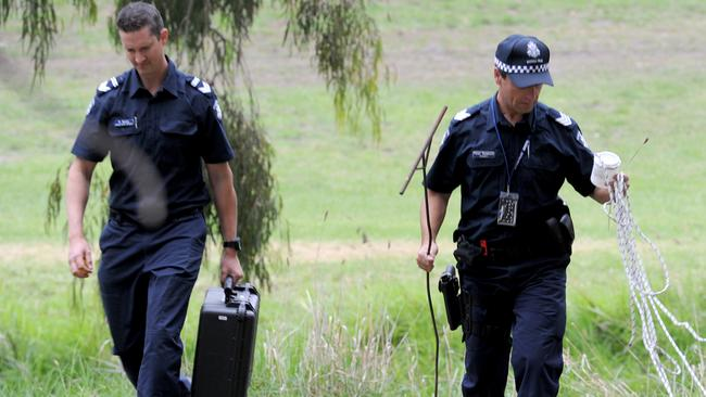 Forensic police on the murder site. Picture: AAP