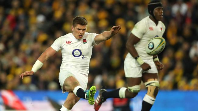 Owen Farrell of England kicks a penalty with Maro Itoje in the background.