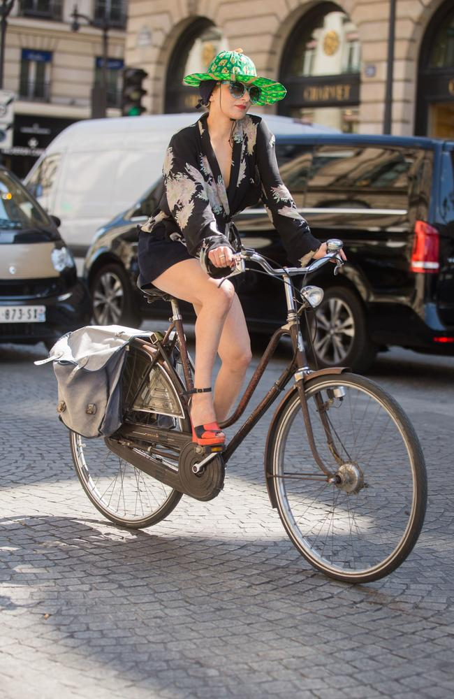 Catherine Baba exits the Schiaparelli show at Hotel d'evreux by bike on July 6, 2015 in Paris. Picture: Melodie Jeng/Getty Images