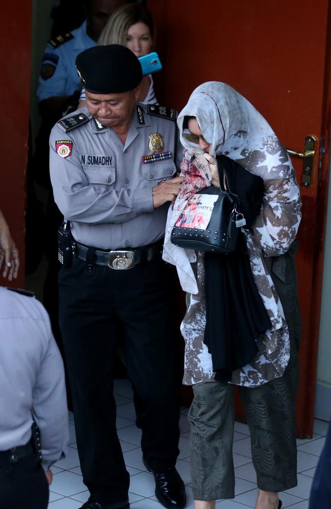 Schapelle Corby leaves while still covering her face with sunnies and a scarf. Picture: Nathan Edwards