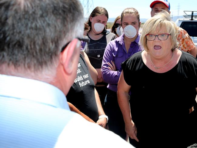 A furious Michelle Coles confronts Ian Hunter at the Northern Power Station in Port Augusta. Picture: Calum Robertson
