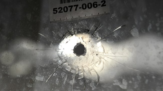 A bullet hole in the front window of a home in Enfield, which was shot at. Picture: Campbell Brodie