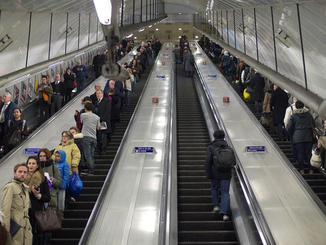 people on escalators. a true londoner knows to stand on the right and walk left. picture people escalators o